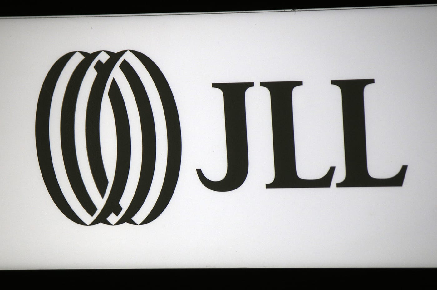 JLL logo sign in black and white